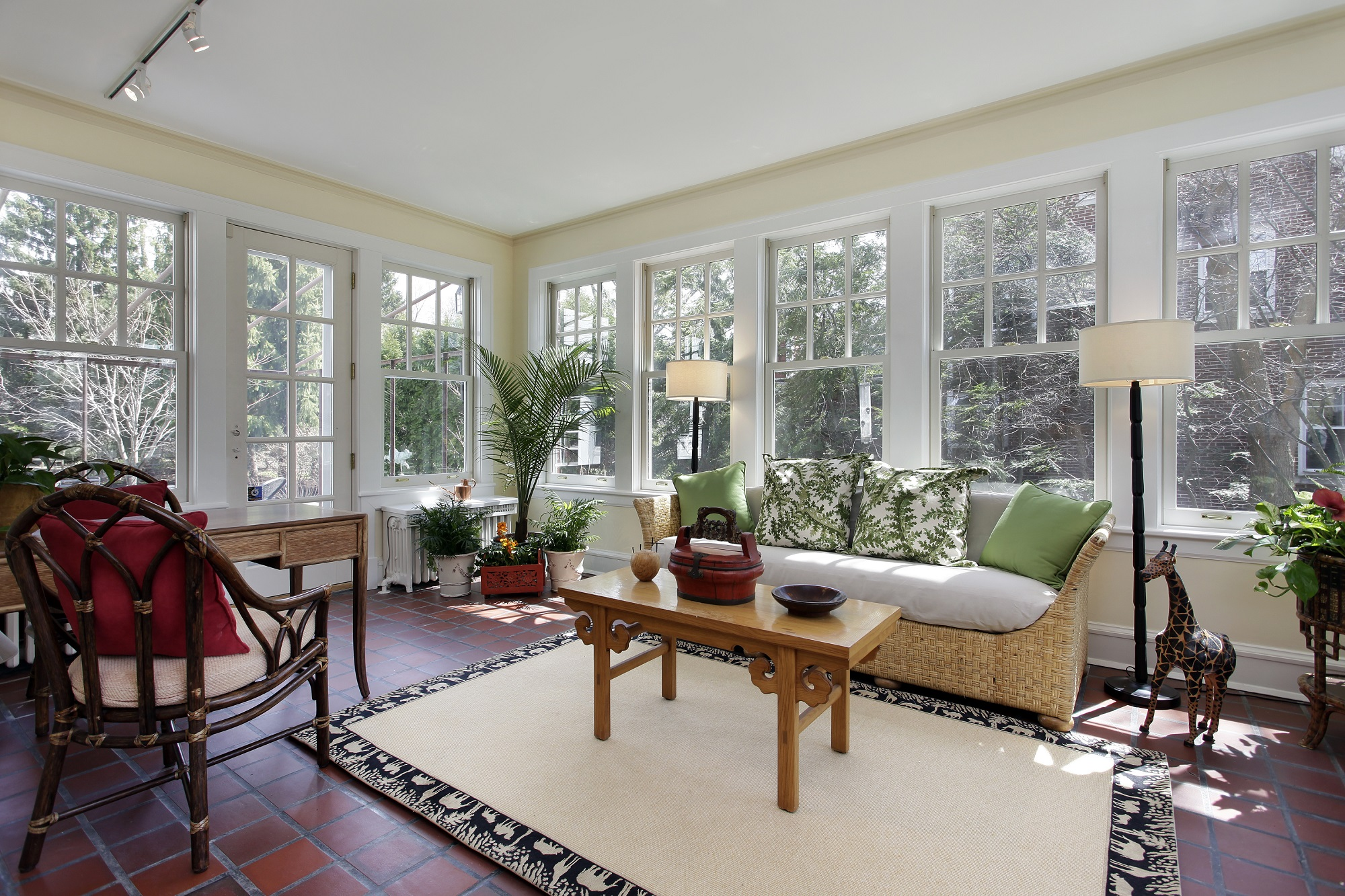 Sunroom with red brick flooring
